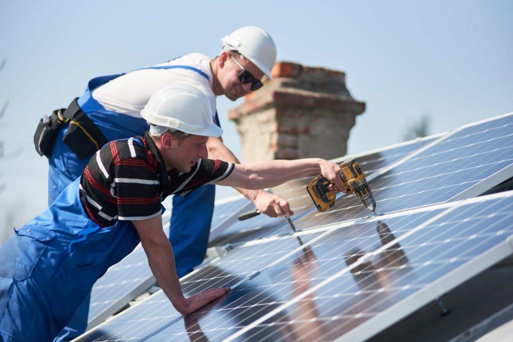 employees installing solar panels