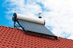 solar panel water heater on a roof