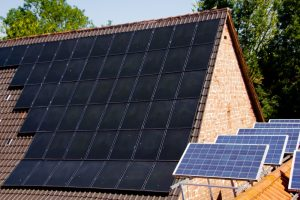 two different types of solar panels on a roof