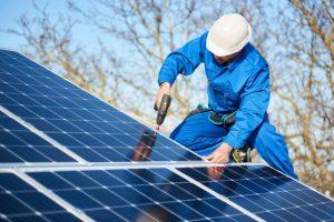Man installing residential solar system